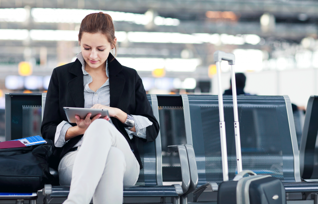 shutterstock_102068095-woman-with-tablet-at-airport-web2
