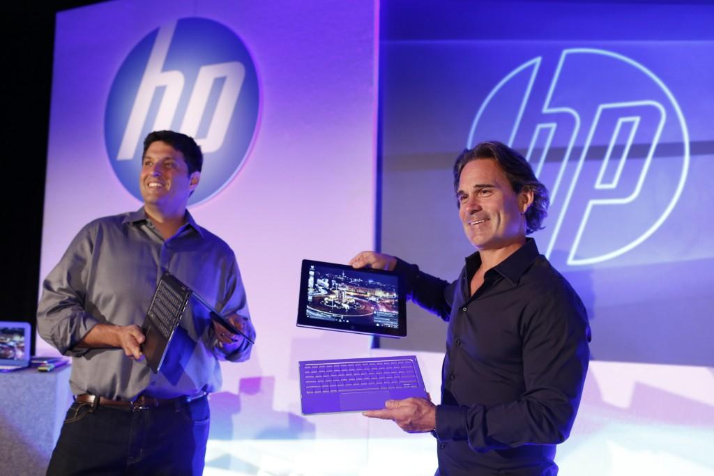 Ron Coughlin de HP y Terry Myerson de Microsoft, en el encuentro.